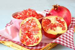 Pomegranate on wooden table, and fresh pomegrante seed in bowl Stock Photography