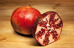 Pomegranate on wooden table Stock Photos