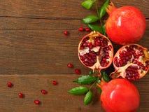 Pomegranate. On woood background Stock Photo