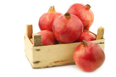Pomegranate & x28;Punica granatum& x29; in a wooden crate Stock Photo