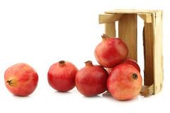 Pomegranate & x28;Punica granatum& x29; in a wooden crate Royalty Free Stock Photography