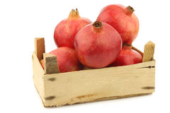 Pomegranate  & x28;Punica granatum& x29; in a wooden crate Royalty Free Stock Image