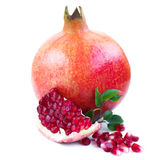 Pomegranates. Pomegranate with leaf on a white background royalty free stock photo