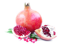 Pomegranates. Pomegranate with leaf on a white background stock photography