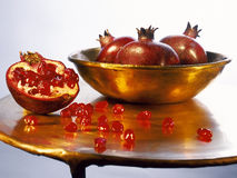 Pomegranates. Juicy ripe pomegranates on a pedestal Stock Photo