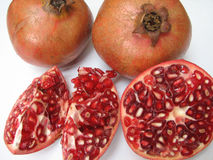 Pomegranates. Full Pomegranates and cut ones on white Background Stock Images