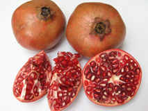 Pomegranates. Full Pomegranates and cut ones on white Background Royalty Free Stock Photos