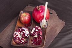 Pomegranates and apple on wood Stock Image