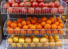 Pomegranates, apples and oranges for sale Royalty Free Stock Photo