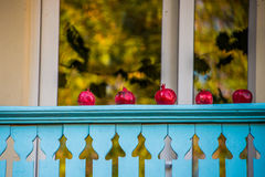 Pomegranates on a balcony Stock Photography