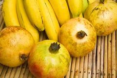 Pomegranates and bananas Stock Photo