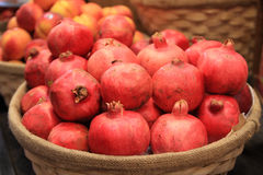 Pomegranates in a basket stock photography