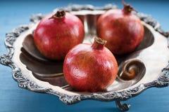 Pomegranates in a Bowl Close up Royalty Free Stock Photos