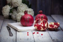 Pomegranates and Chrysanthemums Royalty Free Stock Photography