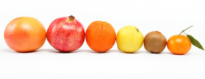 Pomegranates and citrus fruits . Pomegranates and citrus fruits  on a white background Royalty Free Stock Photography
