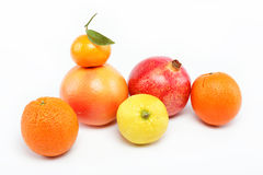 Pomegranates and citrus fruits . Pomegranates and citrus fruits  on a white background Stock Photo