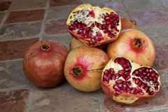 Pomegranates on a counter. Various pomeganates on a counter Stock Images