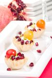 Pomegranates and cream cheese canapes Stock Photography