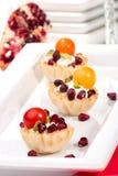 Pomegranates and cream cheese canapes Stock Photos