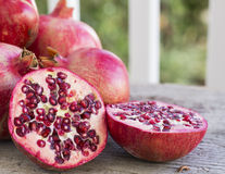 Pomegranates displayed on weathered wood Royalty Free Stock Images