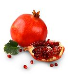 Pomegranates with fruit section isolated on white Royalty Free Stock Photos