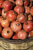 Pomegranates i korg Royaltyfria Bilder