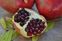 Pomegranates. With leaf, fruit for Fall, ripe fruit Stock Images