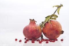 Pomegranates with leaves Royalty Free Stock Image