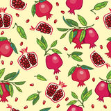 Pomegranates with leaves on light beige background Stock Image