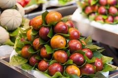 Pomegranates at the market Stock Photo