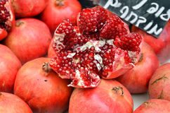 Pomegranates on market stand Stock Images