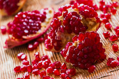 Pomegranates. On old wooden table, selective focus Stock Images