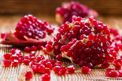 Pomegranates. On old wooden table, selective focus Stock Photography