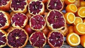 Pomegranates and oranges Royalty Free Stock Photos