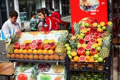 Pomegranates and oranges at the street Stock Image