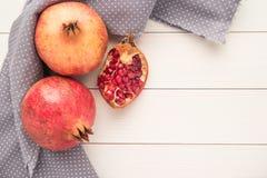 Pomegranates over grunge wooden background royalty free stock image