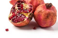 Pomegranates over white stock photo