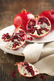 Pomegranates over Wooden Background. Stock Image