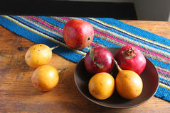 Pomegranates and Passion Fruit in a Bowl Royalty Free Stock Images