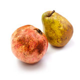 Pomegranates and pear on a white Stock Photography