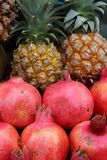 Pomegranates and pineapples in the market at Rosh Hashana Royalty Free Stock Images