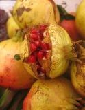 Pomegranates with pomegranate seeds. Pomegranates with exposed pomegranate seeds at street market Stock Photography