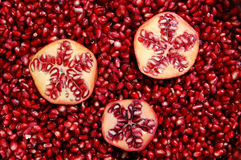 Pomegranates and seeds Stock Photos