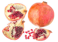 Pomegranates with seeds. Juicy pomegranate with seeds. Isolated on a white background Royalty Free Stock Images