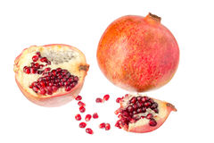 Pomegranates and seeds. Pomegranates and seeds on a white background close-up Stock Photos