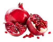 Pomegranates som isoleras på vit Arkivbild