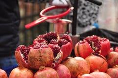 Pomegranates. Stack pomegranates on juice vendor's cart royalty free stock photos