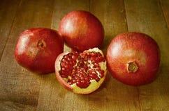 Pomegranates on table. Fresh four pomegranates fruits on a table stock photography
