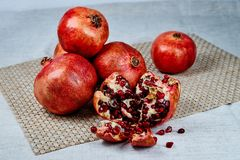 pomegranates on the table on a gray napkin on a linen tablecloth royalty free stock photography