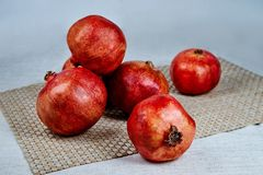 pomegranates on the table on a gray napkin on a linen tablecloth royalty free stock image